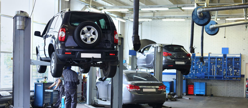 Cars getting serviced in local garage.
