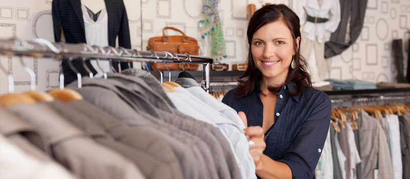 Retail store owner organising clothes