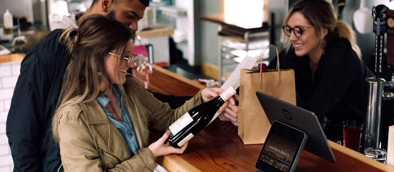 Customers supporting small businesses and shopping at local wine store
